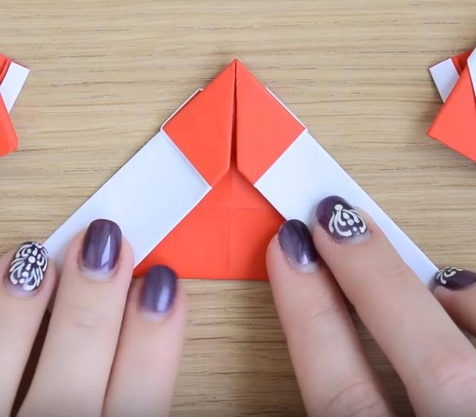 Процесс изготовления деда мороза оригами вариант 2 шаг 9