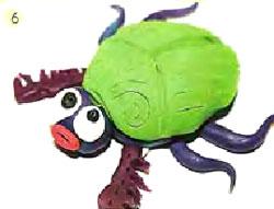 Жук-скарабей из пластилина