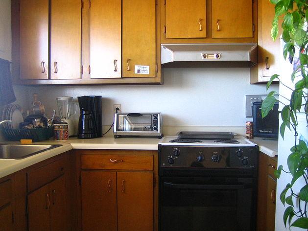 Как установить кухонный шкаф своими руками?