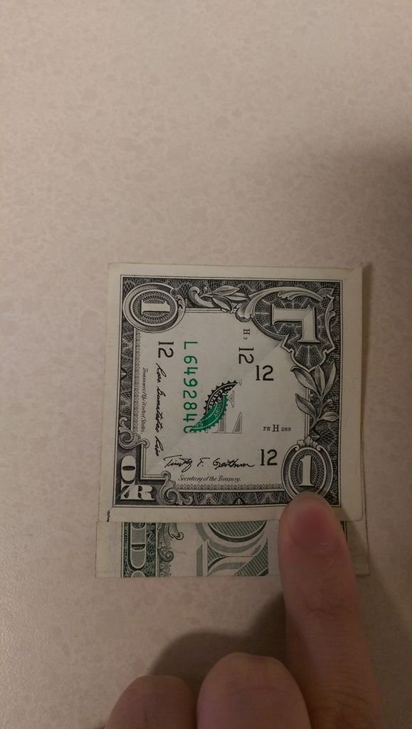 Бабочка из денег в технике оригами